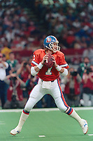 NEW ORLEANS, LA - Quarterback John Elway of the Denver Broncos in action during Super Bowl XXIV against the San Francisco 49ers at the Superdome in New Orleans, Louisiana in January of 1990. Photo by Brad Mangin.