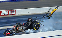 Nov. 10, 2012; Pomona, CA, USA: NHRA funny car driver Todd Lesenko blows the body off his car after an explosion during qualifying for the Auto Club Finals at at Auto Club Raceway at Pomona. Lesenko would be uninjured. Mandatory Credit: Mark J. Rebilas-
