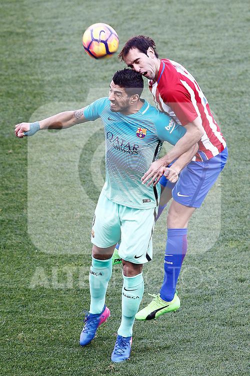 Atletico de Madrid's Diego Godin (r) and FC Barcelona's Luis Suarez during La Liga match. February 26,2017. (ALTERPHOTOS/Acero)