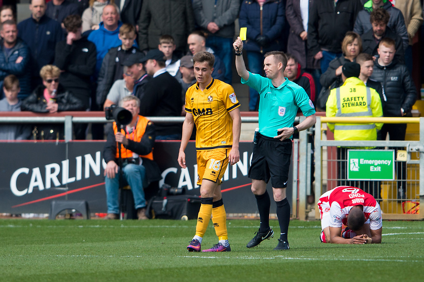Port Vale's Dan Turner is shown a yellow card by referee Ross Joyce<br /> <br /> Photographer Terry Donnelly/CameraSport<br /> <br /> The EFL Sky Bet League One - Fleetwood Town v Port Vale - Sunday 30th April 2017 - Highbury Stadium - Fleetwood<br /> <br /> World Copyright &copy; 2017 CameraSport. All rights reserved. 43 Linden Ave. Countesthorpe. Leicester. England. LE8 5PG - Tel: +44 (0) 116 277 4147 - admin@camerasport.com - www.camerasport.com