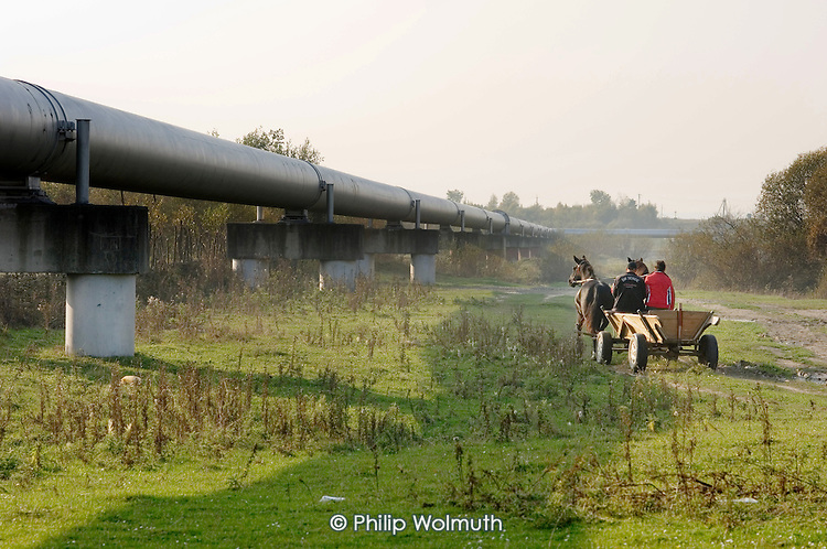 A peasant horse and cart and the Southern Druzhba oil pipeline as it passes through farmland outside the city of Ivano-Frankivsk. The pipe crosses Ukraine, connecting Russia and Hungary.