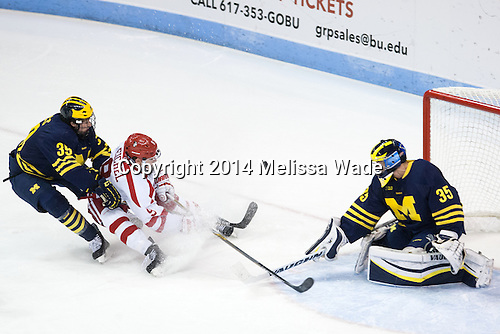 Dexter Dancs (Michigan - 39), Jack Eichel (BU - 9), Zach Nagelvoort (Michigan - 35) - The Boston University Terriers defeated the visiting University of Michigan Wolverines 3-2 on Saturday, October 25, 2014, at Agganis Arena in Boston, Massachusetts.