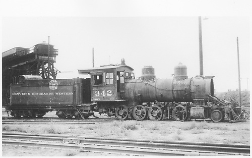 Engineer's-side view of C-19 #342 stripped of hardware and running gear parked at end of Alamosa coaling trestle.<br /> D&amp;RGW  Alamosa, CO  10/1938