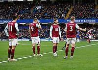 11th January 2020; Stamford Bridge, London, England; English Premier League Football, Chelsea versus Burnley; Jeff Hendrick, Charlie Taylor, Dwight McNeil and Chris Wood of Burnley looking disappointed after Jorginho of Chelsea scores his sides 1st goal from a penalty in the 19th minute to make it 1-0 - Strictly Editorial Use Only. No use with unauthorized audio, video, data, fixture lists, club/league logos or 'live' services. Online in-match use limited to 120 images, no video emulation. No use in betting, games or single club/league/player publications