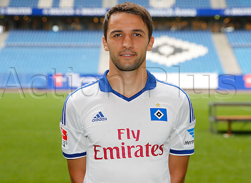 30.07.2013. Hamburg, Germany.  German Bundesliga soccer club Hamburger SV's Milan Badelj poses during the official photo shoot for the season 2013-14 at Hamburg's Imtech Arena stadium.