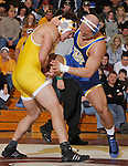 SPEARFISH, S.D. -- 197  Alfonso Hernandez, left, of the University of Wyoming, picks up the leg of Joe Skow of South Dakota State during their 197 lb. match Sunday at the Young Center in Spearfish, S.D.  (Photo by Richard Carlson/Inertia via dakotapress.org)