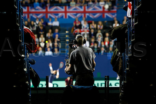 04.03.2016. Barclaycard Arena, Birmingham, England. Davis Cup Tennis World Group First Round. Great Britain versus Japan. A view from outside the court as Andy Murray of Great Britain serves during his singles match against Japan's Taro Daniel on day 1 of the tie.