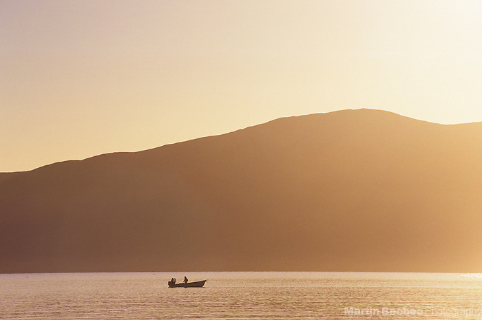A fishing boat starts the day at sunrise on Bahia de los Angeles, Baja California, Mexico