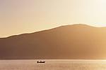 A fishing boat starts the day at sunrise on Bahia de los Angeles, Baja California, Mexico