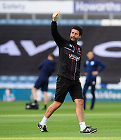 Lincoln City manager Danny Cowley acknowledges the fans during the pre-match warm-up<br /> <br /> Photographer Chris Vaughan/CameraSport<br /> <br /> The Carabao Cup First Round - Huddersfield Town v Lincoln City - Tuesday 13th August 2019 - John Smith's Stadium - Huddersfield<br />  <br /> World Copyright © 2019 CameraSport. All rights reserved. 43 Linden Ave. Countesthorpe. Leicester. England. LE8 5PG - Tel: +44 (0) 116 277 4147 - admin@camerasport.com - www.camerasport.com