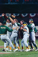 SAN FRANCISCO, CA - Dennis Eckersley and Mark McGwire of the Oakland Athletics celebrates with his teammates after they won Game 4 of the 1989 World Series against the San Francisco Giants, clinching the World Series championship at Candlestick Park in San Francisco, California in 1989. Photo by Brad Mangin