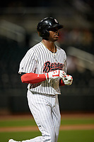 Birmingham Barons Luis Robert (26) jogs to first base after a walk during a Southern League game against the Chattanooga Lookouts on May 1, 2019 at Regions Field in Birmingham, Alabama.  Chattanooga defeated Birmingham 5-0.  (Mike Janes/Four Seam Images)