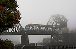 Fog along the Lake Washington Ship Canal. Ballard Railroad Trestle at West end of Chittenden lock. The Sounder commuter train heading into downtown Seattle across the Ballard Railroad Trestle.