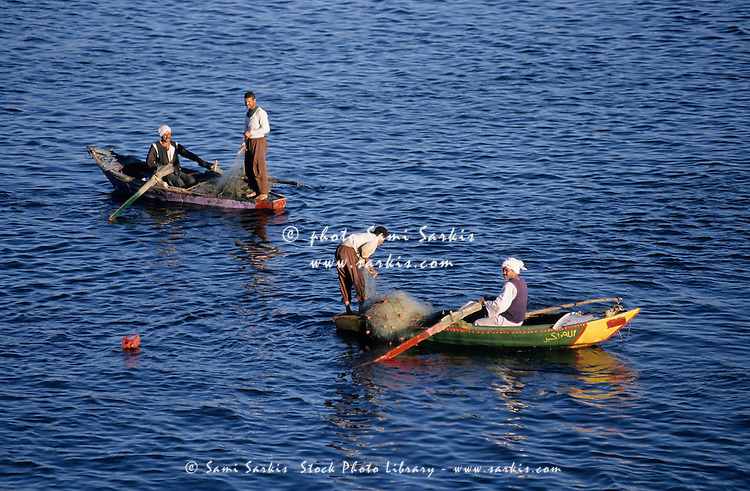 Fishermen with nets in boats on the Nile River, Esna, Egypt.