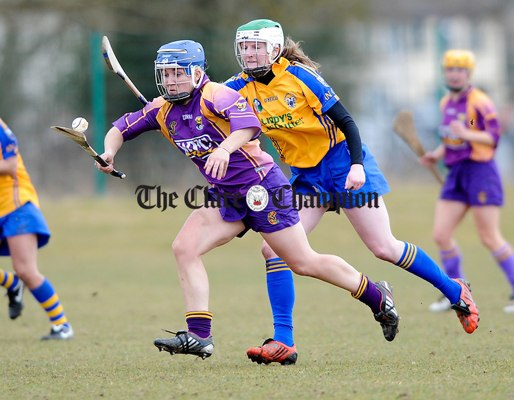 Wexford's Katriona Peacock is tackled by Clare's Siobhan Lafferty during their  Division 1 League game at Clarecastle. Photograph by John Kelly.