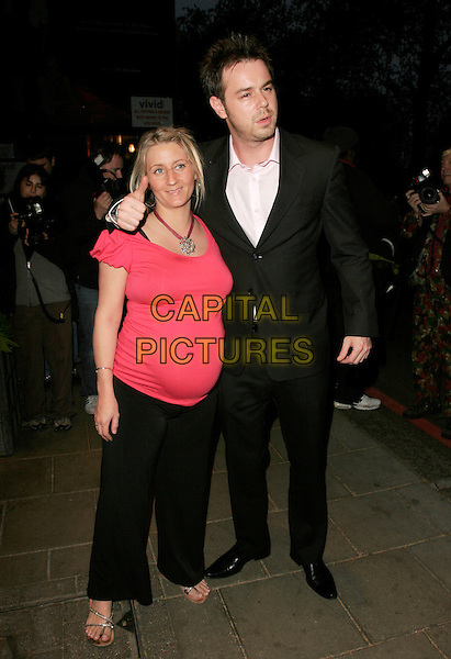 JOANNE & DANNY DYER.UK FiFi Awards, The Dorchester, London, England..April 23rd, 2007.fragrance foundation full length black suit pink top pregnant couple thumb up.CAP/AH.©Adam Houghton/Capital Pictures