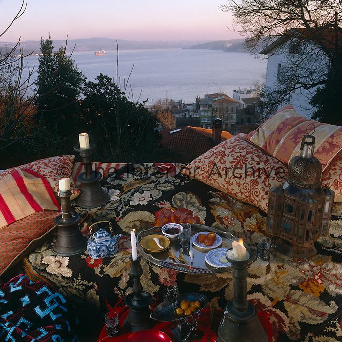 View over the Bosphorus from a terrace strewn with cushions