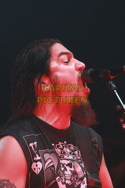 MACHINE HEAD - Robb Flynn .Perform live in concert at the Brixton Academy, London, England, UK, .18th February 2010..gig on stage performing concert music  portrait headshot  singing microphone tattoo black sleeveless beard facial hair profile side .CAP/MAR.© Martin Harris/Capital Pictures.