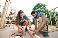 Amanda Wilson, a junior secondary education major from Arlington, Tennessee, and Lewis Smith, a freshman kinesiology major from Carthage, work together on the Maroon Edition Habitat for Humanity home during this week's Service DAWGS Day. The annual day of service connects hundreds of MSU students with community partners for volunteer opportunities. <br />