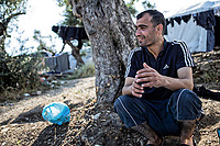 Pictured: A man rests by an olive tree.<br /> Re: Everyday life at the Moria refugee camp on the island of Lesbos, Greece.