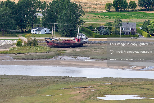 A decaying boat lies on the shore of the riviere Du Gouffre river in the city of Baie St-Paul September 4, 2008.