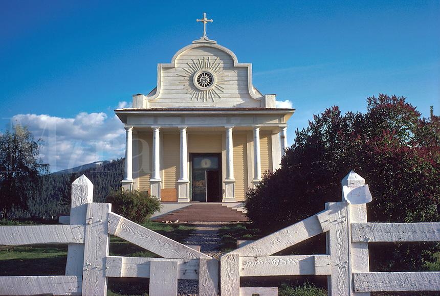 Front facade of historic Cataldo Mission church, the oldest building in Idaho. religions, Christian, Catholic, landmark, architecture. Idaho, Northern Idaho.