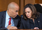 United States Senators Cory Booker (Democrat of New Jersey), left, and Kamala Harris (Democrat of California), right, converse as Judge Brett Kavanaugh testifies before the US Senate Judiciary Committee on his nomination as Associate Justice of the US Supreme Court to replace the retiring Justice Anthony Kennedy on Capitol Hill in Washington, DC on Thursday, September 6, 2018.<br /> Credit: Ron Sachs / CNP<br /> (RESTRICTION: NO New York or New Jersey Newspapers or newspapers within a 75 mile radius of New York City)