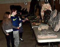 St. Joseph&rsquo;s student&rsquo;s look at a fossils display during the Dinosaurs Rock show at St. Joseph School in Holbrook on Friday February 27, 2015.<br /> (Photo by Gary Wilcox)
