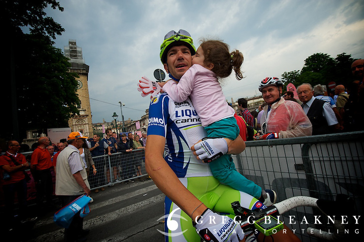 By the start of stage 19, after three weeks of being on the road, Allessandro Vanotti was glad to reunite with his family.  His little girl cried as he set her down and meanered to the starting line.