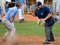 Mark Fleury #8 of the North Carolina Tar Heels reacts as home plate umpire Scott Graham calls him out in the top of the 10th inning versus the Clemson Tigers at Durham Bulls Athletic Park May 23, 2009 in Durham, North Carolina. The Tigers defeated the Tar Heals 4-3 in 11 innings.  (Photo by Brian Westerholt / Four Seam Images)