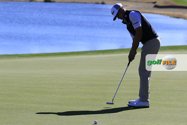 Dominic Bozzelli (USA) putts on the 18th green during Saturday's Round 3 of the 2017 CareerBuilder Challenge held at PGA West, La Quinta, Palm Springs, California, USA.<br /> 21st January 2017.<br /> Picture: Eoin Clarke | Golffile<br /> <br /> <br /> All photos usage must carry mandatory copyright credit (&copy; Golffile | Eoin Clarke)