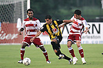 7 August 2007: Charleston's Byron Alvarez (center) dribbles away from FC Dallas's Marcelo Saragosa (5) and Adrian Serioux (15). FC Dallas of Major League Soccer defeated the Charleston Battery of the United Soccer League first division 2-1 after extra time in a quarterfinal match of the 2007 US Open Cup tournament at Blackbaud Stadium in Charleston, SC...