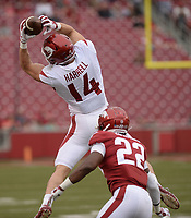 NWA Democrat-Gazette/ANDY SHUPE<br /> Arkansas tight end Chase Harrell (14) reaches to make a catch Saturday, April 6, 2019, in front of linebacker Deon Edwards (22) during the Razorbacks' spring game in Razorback Stadium in Fayetteville. Visit nwadg.com/photos to see more photographs from the game.