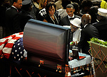 A woman cries as she looks at the body of firefighter Kevin Bell, during the funeral service, Monday, Oct. 13, 2014, at First Cathedral Church in Bloomfield. Bell was killed at a house fire in last week Hartford. (Jim Michaud / Journal Inquirer)