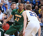 SIOUX FALLS, SD - MARCH 10: Lawrence Alexander #12 of North Dakota State looks past South Dakota State defender Reed Tellinghuisen #23 in the first half of the men's Summit League Championship Tournament game Tuesday at the Denny Sanford Premier Center in Sioux Falls, SD. (Photo by Dick Carlson/Inertia)