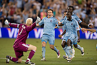Jimmy Nielsen, Matt Besler, Kei Kamara, Lawrence Olum. Sporting Kansas City won the Lamar Hunt U.S. Open Cup on penalty kicks after tying the Seattle Sounders in overtime at Livestrong Sporting Park in Kansas City, Kansas.