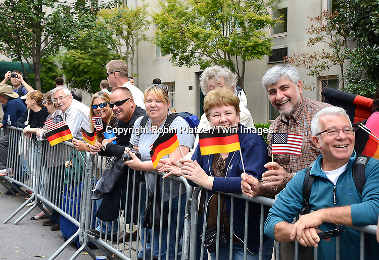 Spectators watch the Steuben Parade on Fifth Avenue in New York City on September 20. 2014. <br /> <br /> photo by Robin Platzer/Twin Images<br />  <br /> phone number 212-935-0770