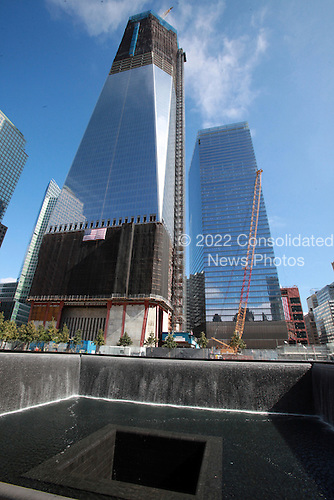 Two days before the 10th anniversary of the 9/11 attacks, September 9, 2011, the Freedom Tower (left) rises above the World Trade Center site in New York, New York..Credit: Sipa Press via CNP