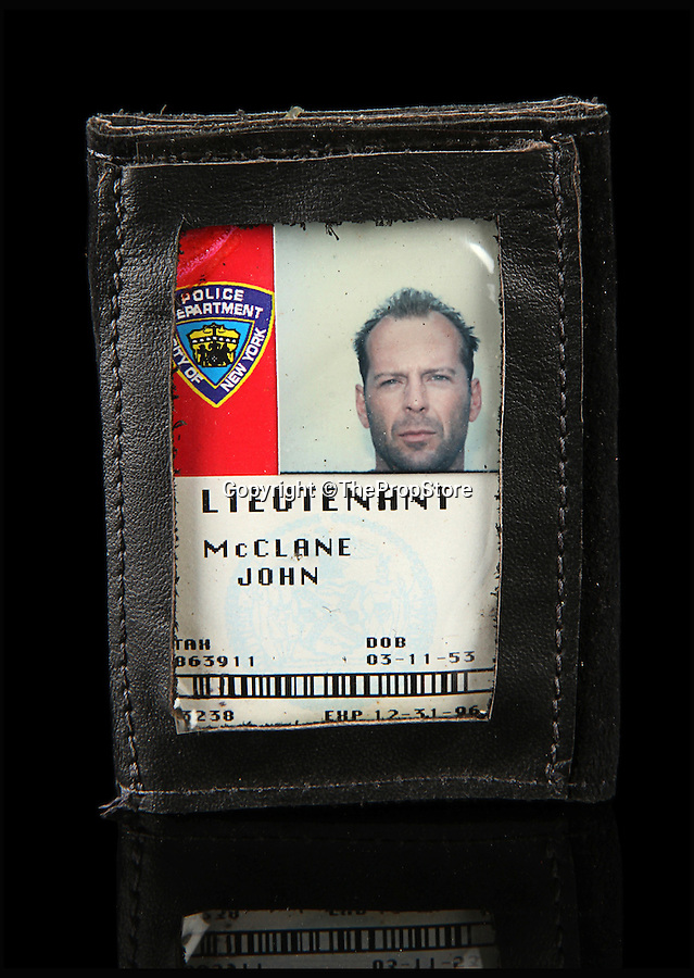 BNPS.co.uk (01202 558833)<br /> Pic: ThePropStore/BNPS<br /> <br /> Bruce Willis's John McClane ID badge from Die Hard With A Vengence.<br /> <br /> Stop! Police! - Hollywoods finest...and funniest id badges come up for auction.<br /> <br /> The world's largest ever collection of IDs belonging to a who's who of film and TV stars is set to be auctioned. <br /> <br /> Credentials used by Hollywood royalty including Jodie Foster, Bruce Willis, Leonardo DiCaprio, Jeremy Irons, Eddie Murphy and Kiefer Sutherland are all about to go under the hammer. <br /> <br /> The lots are being sold on behalf of an anonymous collector who amassed the collection over a period of 15 years. <br /> <br /> They will be auctioned by the Prop Store in London on Tuesday, September 27.