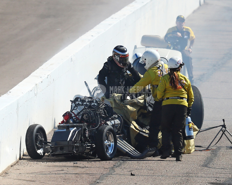 Feb 25, 2018; Chandler, AZ, USA; NHRA funny car driver Jonnie Lindberg climbs from his car after crashing with John Force during the Arizona Nationals at Wild Horse Pass Motorsports Park. Mandatory Credit: Mark J. Rebilas-USA TODAY Sports