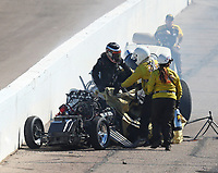 Feb 25, 2018; Chandler, AZ, USA; NHRA funny car driver Jonnie Lindberg climbs from his car after crashing with John Force during the Arizona Nationals at Wild Horse Pass Motorsports Park. Mandatory Credit: Mark J. Rebilas-USA TODAY Sports
