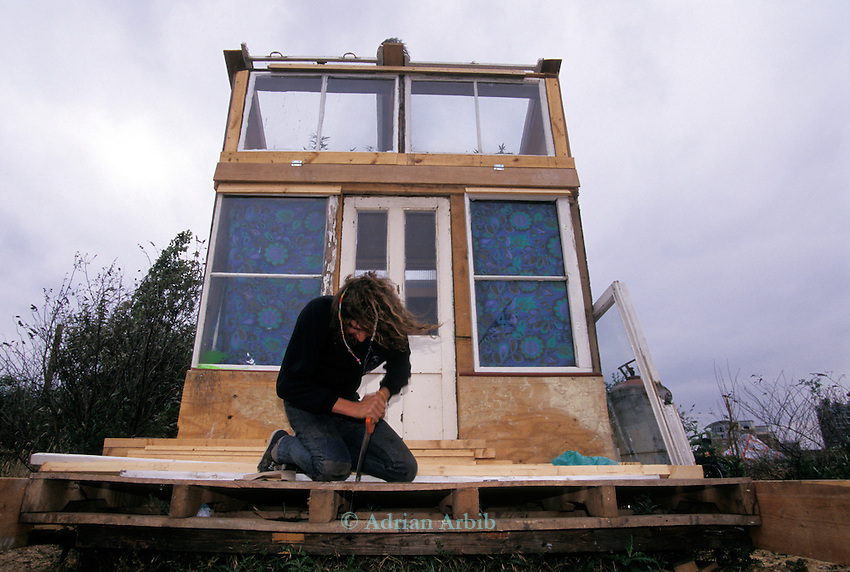 Dave building his house from skip found  scrap. Wandsworth Eco village.