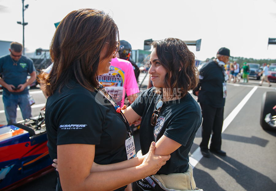Mar 15, 2019; Gainesville, FL, USA; NHRA top alcohol dragster driver Jasmine Salinas (right) with mother Monica Salinas during qualifying for the Gatornationals at Gainesville Raceway. Mandatory Credit: Mark J. Rebilas-USA TODAY Sports