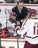 Michael Sit (BC - 18), Mike Cavanaugh (BC - Associate Head Coach), Kevin Hayes (BC - 12) - The Boston College Eagles defeated the visiting University of New Hampshire Wildcats 5-2 on Friday, January 11, 2013, at Kelley Rink in Conte Forum in Chestnut Hill, Massachusetts.