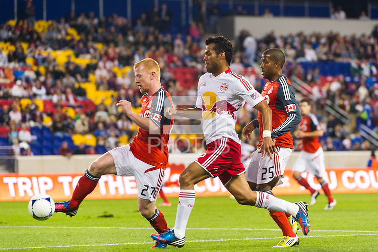 Richard Eckersley (27) of Toronto FC and Wilman Conde (2) of the New York Red Bulls. The New York Red Bulls defeated Toronto FC 4-1 during a Major League Soccer (MLS) match at Red Bull Arena in Harrison, NJ, on September 29, 2012.