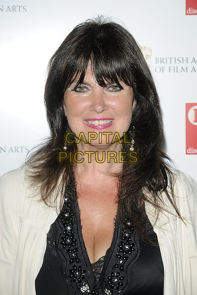 CAROLINE MUNRO .At the BAFTA & BFI Tribute to Ray Harryhausen, BFI Southbank, London, England, UK, June 26th 2010..portrait headshot fringe smiling  black top white cream cardigan beaded embellished .CAP/CAN.©Can Nguyen/Capital Pictures.
