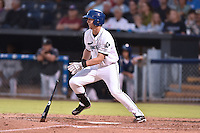 Asheville Tourists third baseman Ryan McMahon #5 swings at a pitch during a game against the Hagerstown Sun at McCormick Field on September 8, 2014 in Asheville, North Carolina. The Tourists defeated the Suns 16-7. (Tony Farlow/Four Seam Images)