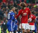 Eden Hazard of Chelsea and Marouane Fellaini of Manchester United during the English Premier League match at Old Trafford Stadium, Manchester. Picture date: April 16th 2017. Pic credit should read: Simon Bellis/Sportimage