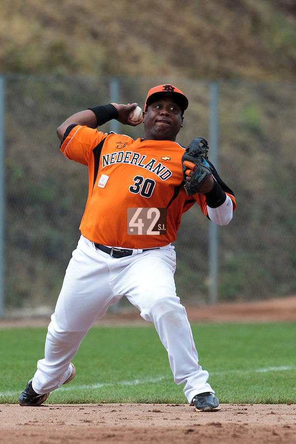 24 july 2010: Raylinoe Legito of Netherlands throws the ball to first base prior to Netherlands 10-0 victory over France, in day 2 of the 2010 European Championship Seniors, in Neuenburg, Germany.