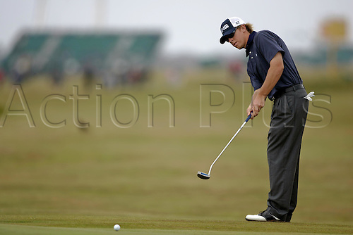 17 July 2004: American golfer Hunter Mahon (USA) putts on the 4th green during the third round of The Open Championship played at Royal Troon, Scotland. Photo: Glyn Kirk/Action Plus...golf golfer putter putting putt 040717.British
